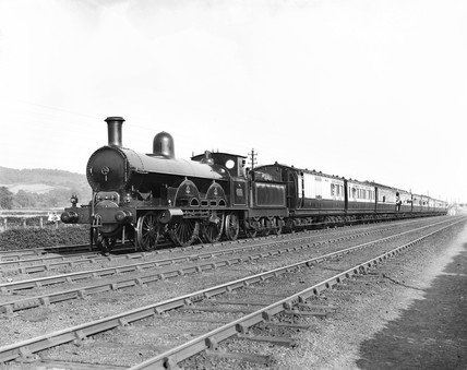 2-4-2 locomotive and train at Whitmore, 1895.