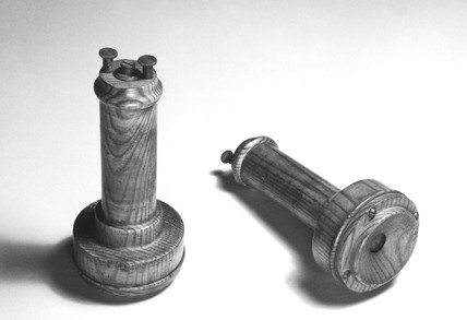 Early telephone receivers, late 19th-early 20th century.