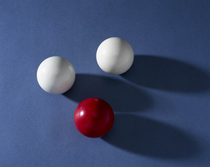 Three billiard balls made of urea formaldehyde, c 1930s.