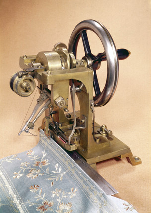 Early sewing machine by Elias Howe, c 1846.