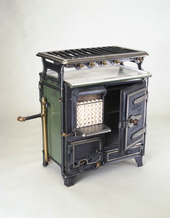 'Stimex' combination gas cooking range, fire and water circulator, c 1922.