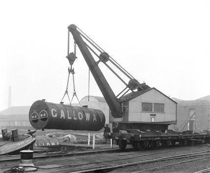 Crane with a heavy load at Poplar Dock, London, c 1900.