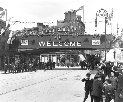 Crowds outside Poplar Station, London, 22 May 1897.