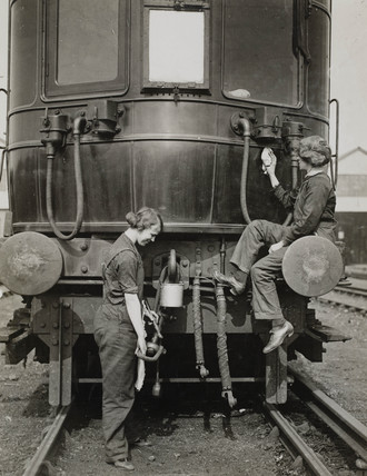 Women carriage cleaners, London & South Western Railway, WWI, c 1916.