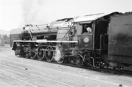 A 15F class locomotive and passenger train, Pretoria, South Africa, 1968.