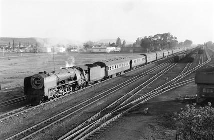 A 15F class locomotive and passenger train, Bloemfontein, 1968.