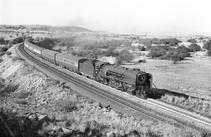 Steam locomotive with a passenger train, near Karee, South Africa, 1968.