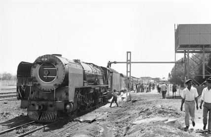 Steam locomotive and passenger train, Orange River, South Africa, 1968.