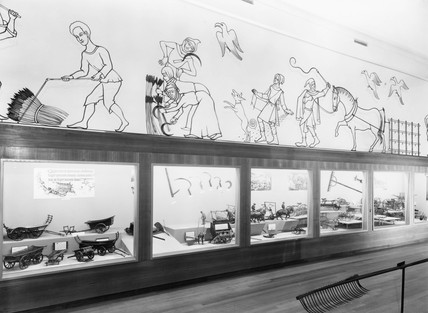 Cyclorama; cases of wagons, reapers, etc, Science Museum, London, 1951.