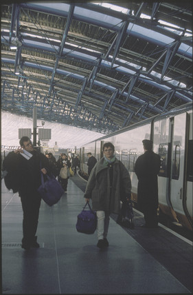 Passengers at Waterloo Station, London, 1999.