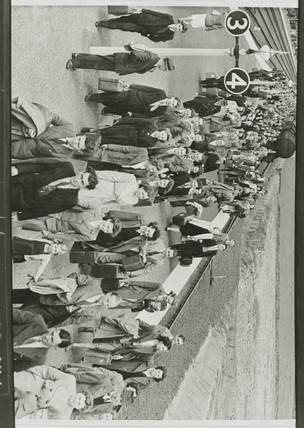Passengers leaving a train, c 1950.