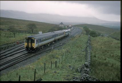 Train going past signals, Blea Moor, 1994.