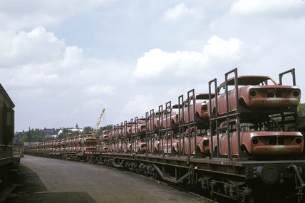 New cars on a freight train at Luton, Bedfordshire, 1965.