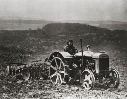Fordson tractor pulling disc harrow, c 1942.