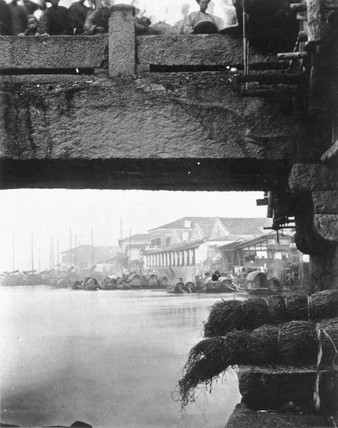 'Part of the Lower Bridge', China, c 1871.