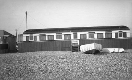 Railway carriage converted into a beach hut, 4 July 1939.