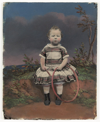Little girl with a hoop, c 1860.