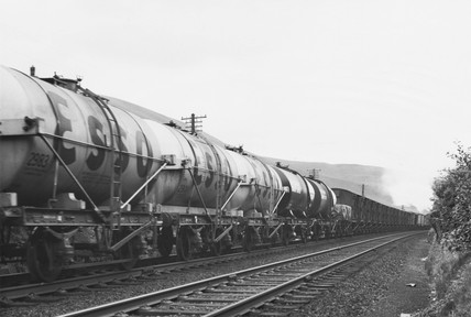 Train of Esso tank wagons and mixed freight.