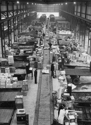Road wagons being loaded in goods depot, c 1950s?