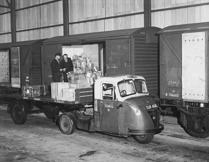 BR mechanical horse being loaded from wagons, c 1950s?