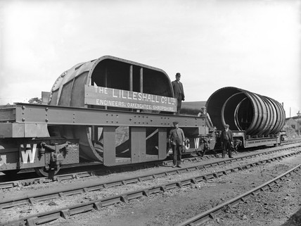 Goods train carrying mining equipment, Oakengates Station, Shropshire 1911.
