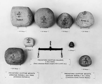 Prehistoric Egyptian limestone balances and weights, 5000 - 7000 BC.