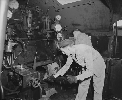 Driver and fireman on the footplate of a steam locomotive, 1957.