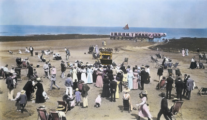 Crowds at the beach, c 1900.