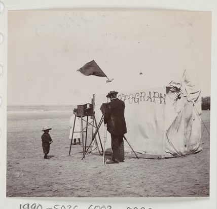 Snap-shot of a beach photographer at Whitby, North Yorkshire, c 1900s.