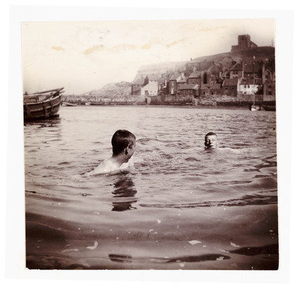 Two boys swimming in Whitby Harbour, North Yorkshire, c 1902.