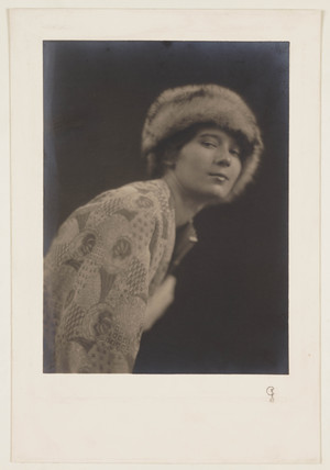 Woman in fur cap, c 1915.