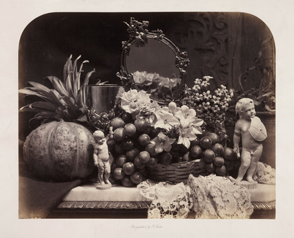 Still life with figures, flowers and fruit, c 1860.