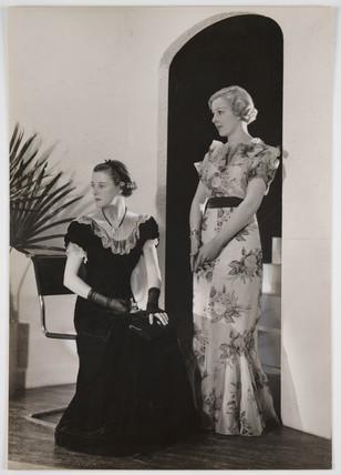 Two women in evening dress, 1936.