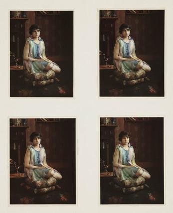 Girl sitting on a cushion, c 1920s.