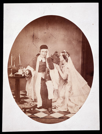 Priest and a woman, c 1860.