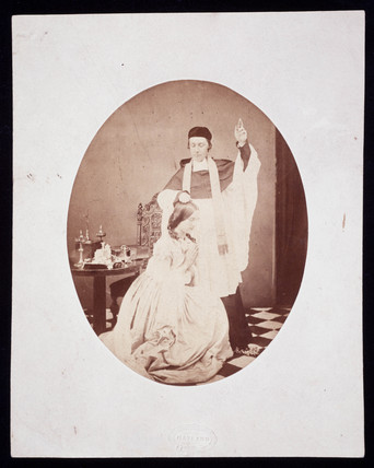 A priest blessing a woman, c 1860.