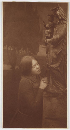Woman praying, c 1906.
