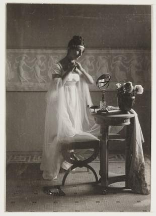 Classical costume scene, c 1905.