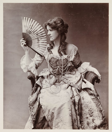 Edwardian portrait, woman in 18th-century dress holding a fan.