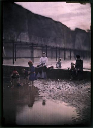 Children by the breakwater, c.1908.