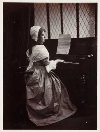 Edwardian portrait, woman playing a keyboard instrument.