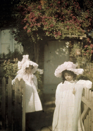 Two girls at the gate.