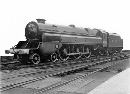 Forward turbine side view of LMS steam turbine locomotive, No. 6202, 4-6-2.