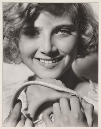 Portrait of a smiling woman, c 1930s.