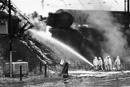 Firefighters dousing burning petrol tankers, Moore, Cheshire, 1983.