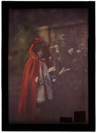 'Joan in Red Riding Hood Cape with basket', 1907.
