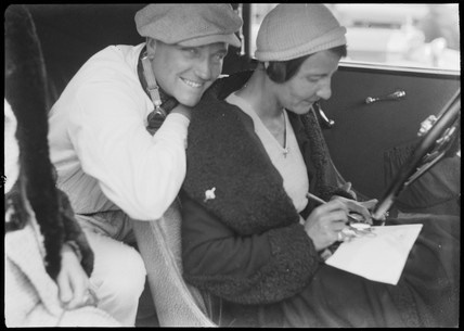 Manfred von Brauchitsch and female timekeeper sitting in vehicle, 1932.
