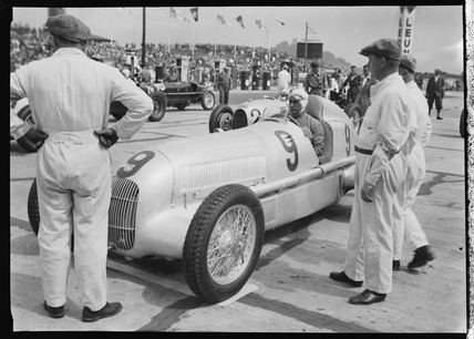Luigi Fagioli at wheel of Mercedes-Benz W25 GP racing car, 1934.