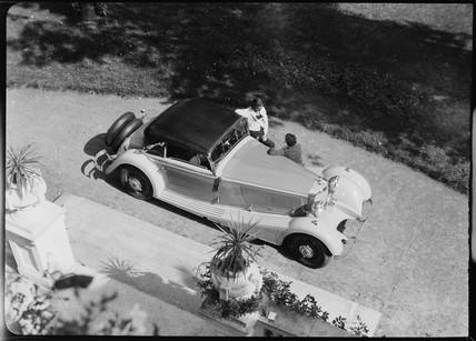 Mercedes-Benz 380 Cabriolet A convertible in a garden scene, 1934.