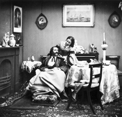 Wife caring for her invalid husband, c 1860s.